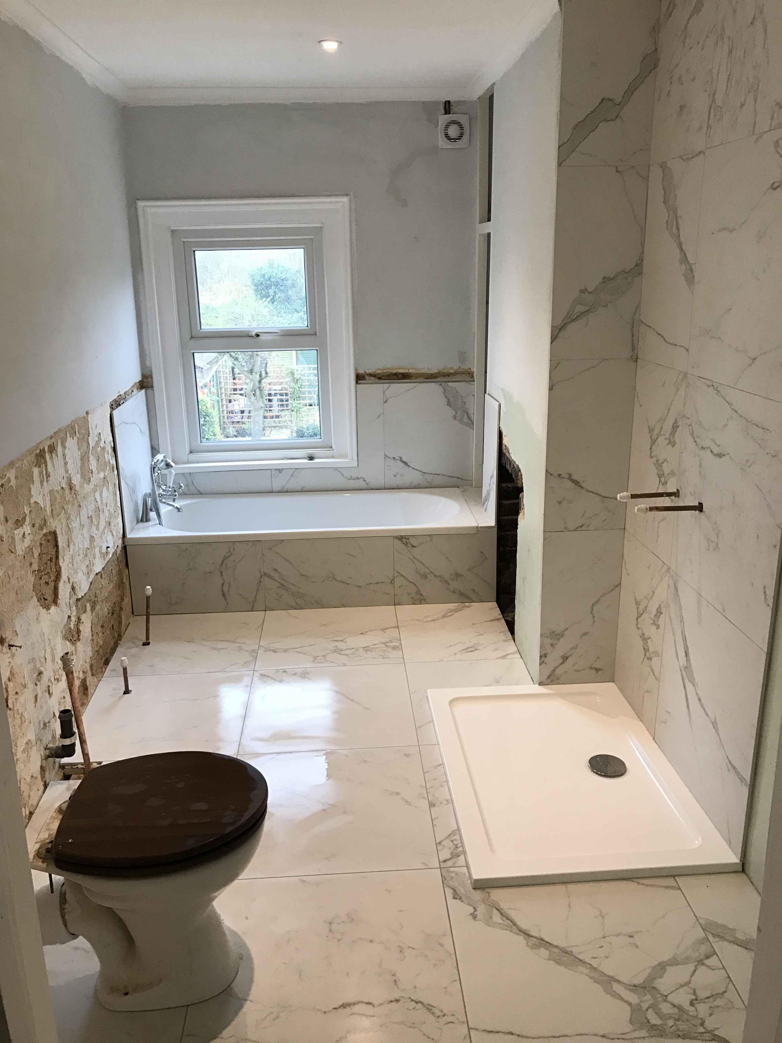 The goal was to create a boutique hotel style bathroom traditional with a contemporary twist. I wanted to see marble tiles and wooden panelling! & Creating Your Own Boutique Hotel Style Bathroom